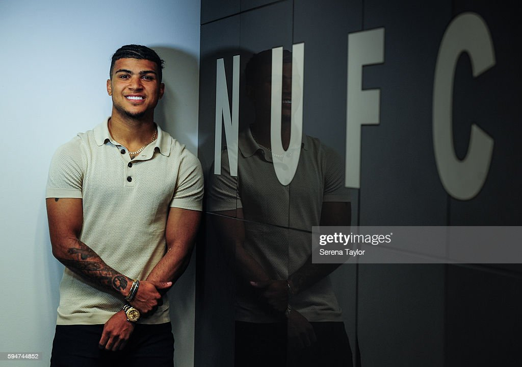 DeAndre Yedlin poses for a photograph with the NUFC sign after signing a 5 year contract at St.James' Park on August 24, 2016, in Newcastle upon Tyne, England.