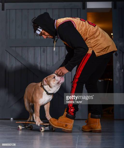 DeAndre Yedlin poses for photos with his English Bulldog, Simba during a photo shoot in Jesmond on November 30 in Newcastle upon Tyne, England.