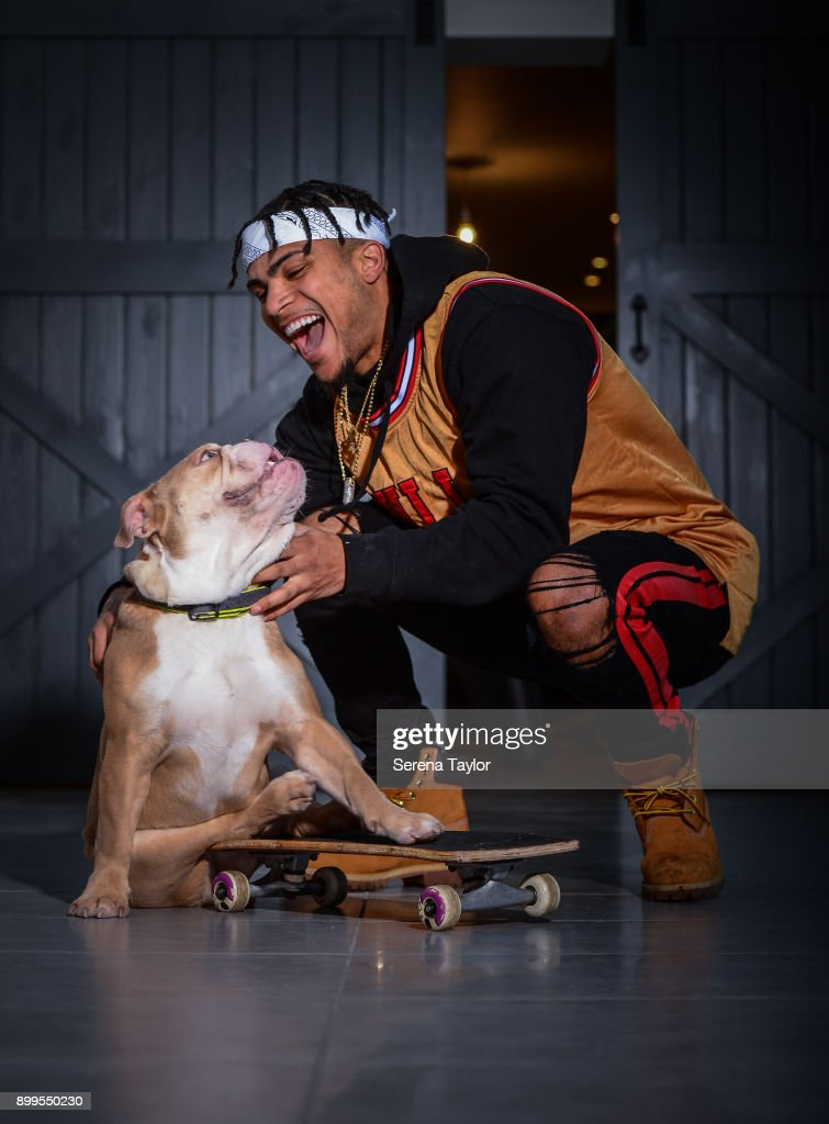 DeAndre Yedlin poses for photos with his English Bulldog, Simba during a photo shoot in Jesmond on November 30, 2017, in Newcastle upon Tyne, England.
