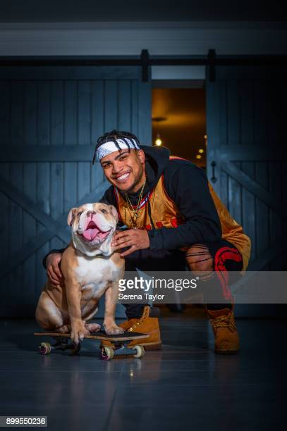 DeAndre Yedlin poses for photos with his English Bulldog Simba during a photo shoot in Jesmond on November 30 in Newcastle upon Tyne England