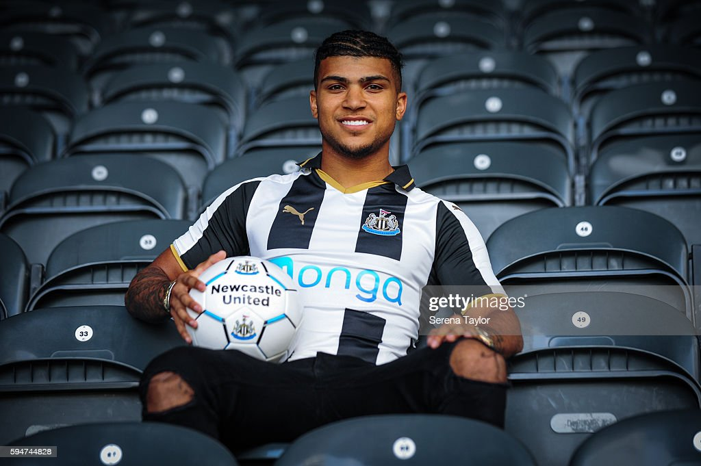 DeAndre Yedlin sits in the stands wearing a club shirt and holding a football after signing a 5 year contract at St.James' Park on August 24, 2016, in Newcastle upon Tyne, England.