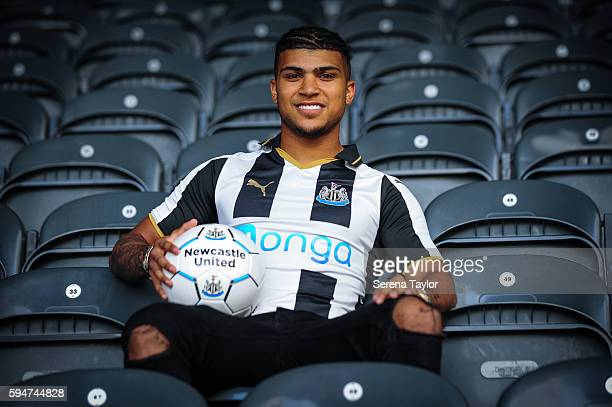 DeAndre Yedlin sits in the stands wearing a club shirt and holding a football after signing a 5 year contract at St.James' Park on August 24 in...