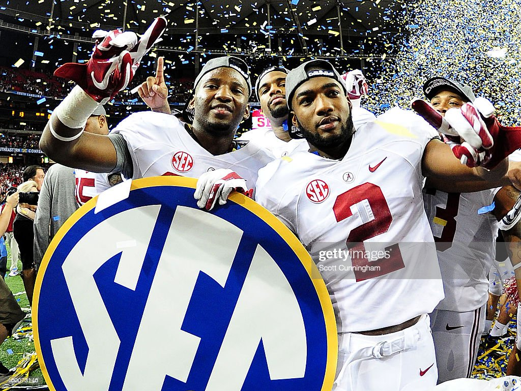 DeAndrew White #2 of the Alabama Crimson Tide celebrates with teammates after their 42 to 13 win over the Missouri Tigers in the SEC Championship game at the Georgia Dome on December 6, 2014 in Atlanta, Georgia.
