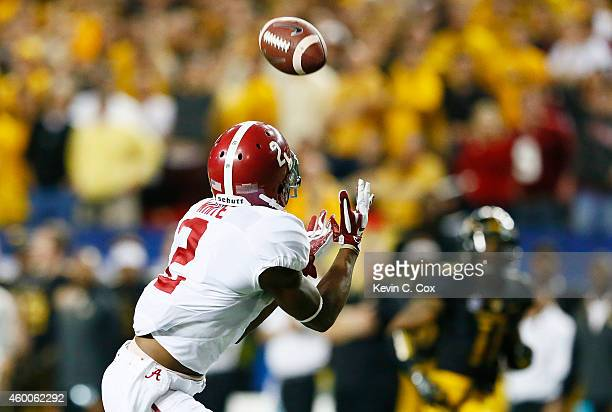 DeAndrew White of the Alabama Crimson Tide completes a reception for a touchdown against the Missouri Tigers in the second quarter of the SEC...