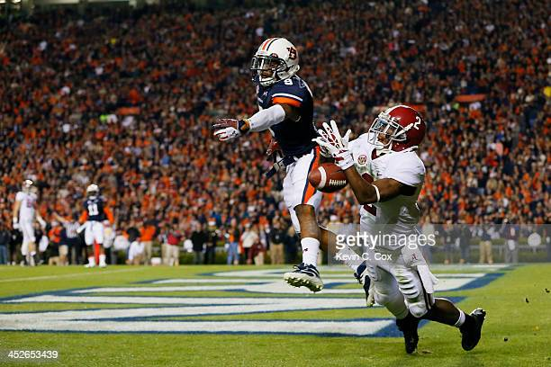 DeAndrew White of the Alabama Crimson Tide fails to complete a third quarter pass against the defense of Jermaine Whitehead of the Auburn Tigers at...