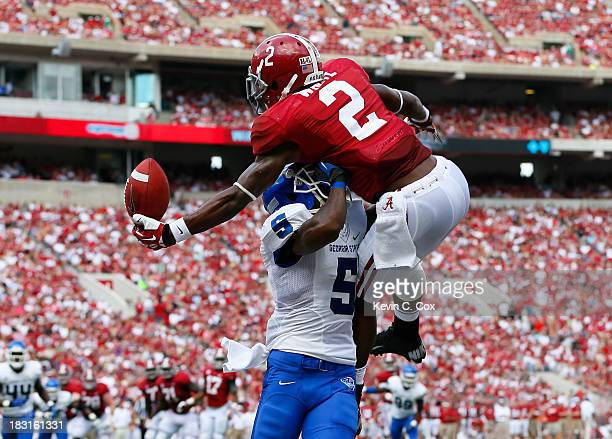 DeAndrew White of the Alabama Crimson Tide pulls in a touchdown reception against Demarius Matthews of the Georgia State Panthers during the first...