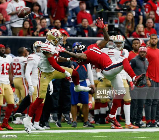 DeAndrew White of the Houston Texans is unable to hold on to the ball as Adrian Colbert of the San Francisco 49ers defends at NRG Stadium on December...