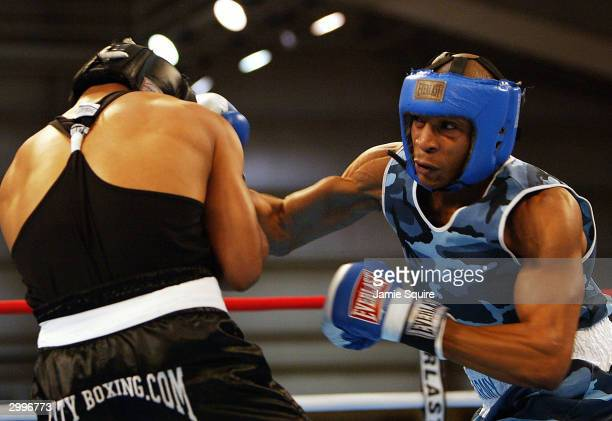 DeAndrey Abron lands a punch in his bout against Yukence Andino during the United States Olympic Team Boxing Trials at Tunica Arena and Exposition...