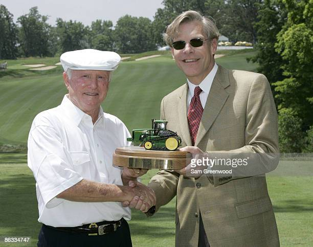 Deane Beman left is presented with a plaque from Bill Lane CEO of the John Deere Company following the Drive for a Billion ceremony at the 2005 John...