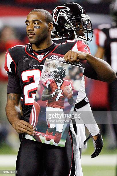 DeAngelo Hall of the Atlanta Falcons holds up a poster of Michael Vick during player intros against the New Orleans Saints on December 10, 2007 at...