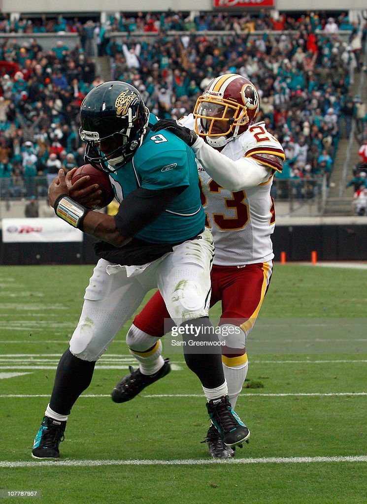 DeAngelo Hall #23 of the Washington Redskins attempts to tackle Quarterback David Garrad #9 of the Jacksonville Jaguars during the game at EverBank Field on December 26, 2010 in Jacksonville, Florida.