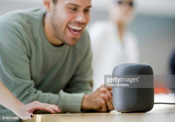 Deangelo Rodriguez gives voice commands to an Apple HomePod speaker at the company's retail store in San Francisco California on February 9 2018 /...