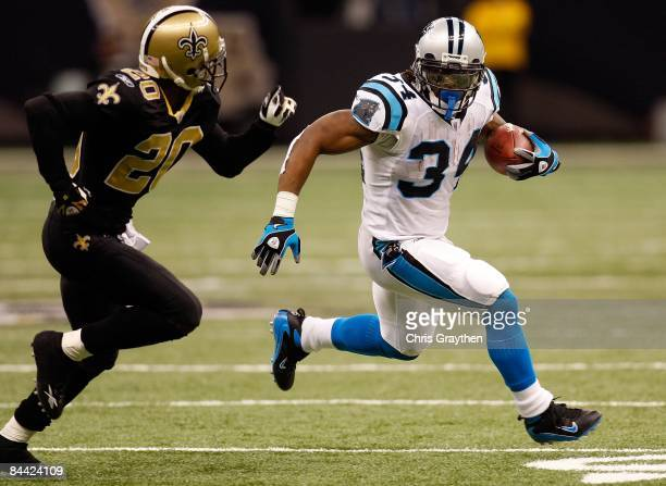 DeAngelo Williams of the Carolina Panthers avoids a tackle by Randall Gay of the New Orleans Saints on December 28 2008 at the Superdome in New...