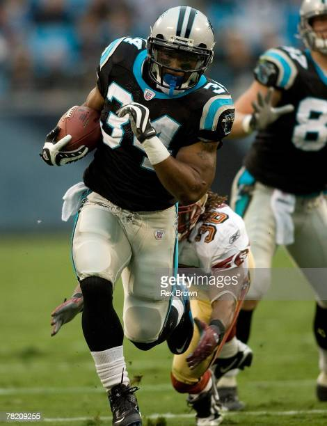 DeAngelo Williams of the Carolina Panthers carries as Dashon Goldson of the San Francisco 49ers works to run him down at Bank of America Stadium on...