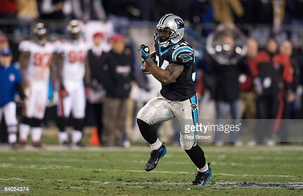 DeAngelo Williams of the Carolina Panthers carries for a first down against the Tampa Bay Buccaneers on December 8 2008 at Bank of America Stadium in...