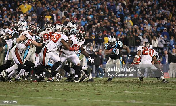 DeAngelo Williams of the Carolina Panthers carries the ball against the Tampa Bay Buccaneers at Bank of America Stadium on December 8 2008 in...
