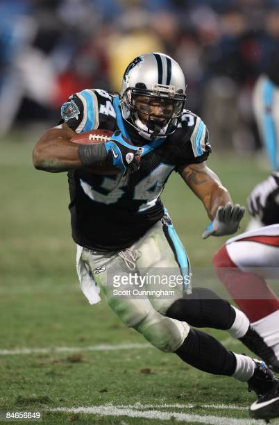 DeAngelo Williams of the Carolina Panthers carries the ball during the NFC Divisional Playoff Game against the Arizona Cardinals at Bank of America...