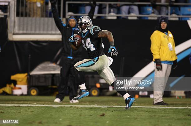 DeAngelo Williams of the Carolina Panthers carries the ball for a touchdown against the Tampa Bay Buccaneers at Bank of America Stadium on December 8...