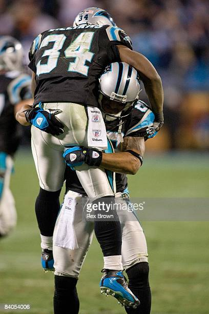 DeAngelo Williams of the Carolina Panthers celebrates with teammate Steve Smith after a scoring a touchdown against the Tampa Bay Buccaneers on...