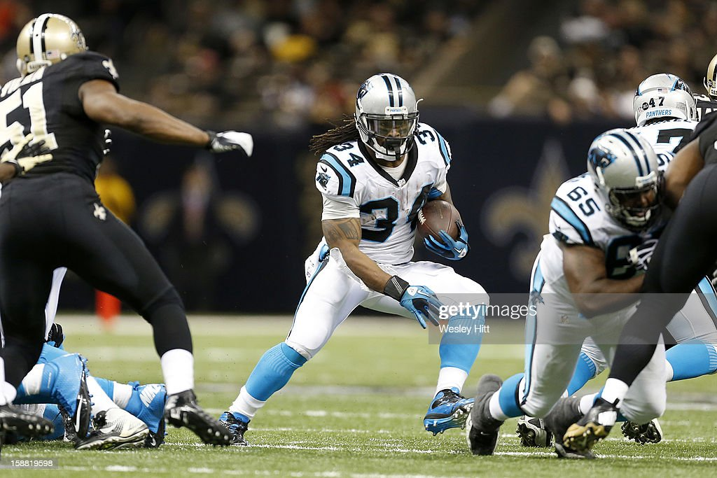 DeAngelo Williams #34 of the Carolina Panthers runs the ball against the New Orleans Saints at Mercedes-Benz Superdome on December 30, 2012 in New Orleans, Louisiana. The Panthers defeated the Saints 44-38.