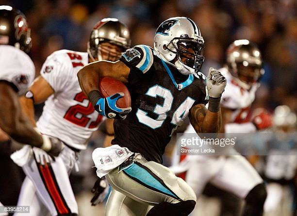DeAngelo Williams of the Carolina Panthers runs with the ball during their game against the Tampa Bay Buccaneers at Bank of America Stadium on...