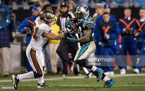 DeAngelo Williams of the Carolina Panthers works to get by Barrett Ruud of the Tampa Bay Buccaneers during the second half on December 8 2008 at Bank...