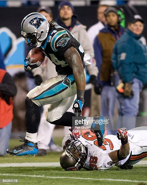 DeAngelo Williams of the Carolina Panthers works to get by Tanard Jackson of the Tampa Bay Buccaneers during the second half on December 8 2008 at...