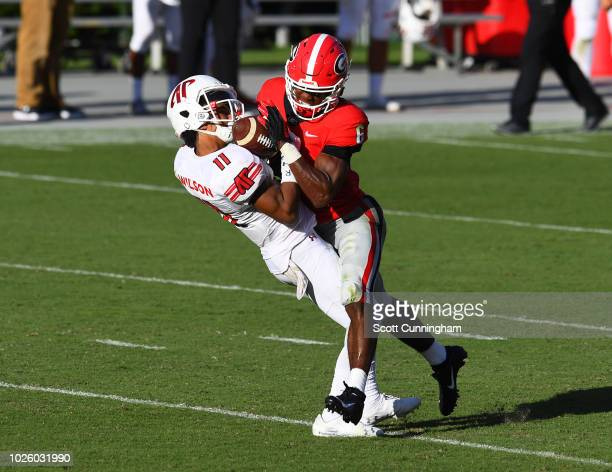 Deangelo Wilson of the Austin Peay Governors is hit by James Cook of the Georgia Bulldogs on September 1 2018 in Athens Georgia Cook would be ejected...