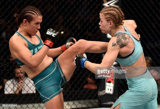 DeAnna Bennett kicks Melinda Fábián of Hungary in their women's flyweight bout during the TUF Finale event inside Park Theater on December 01 2017 in...