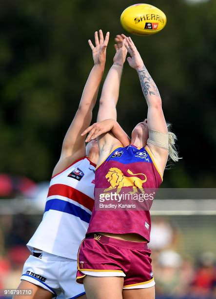 Deanna Berry of the Bulldogs and Nicole Hildebrand of the Lions compete for the ball during the round two AFLW match between the Brisbane Lions and...