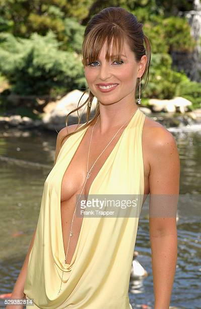 Deanna Brooks poses at the Playboy Playmate of the Year 2004 presentation Carmella DeCesare was named Playboy's Playmate of the Year 2004 at the...