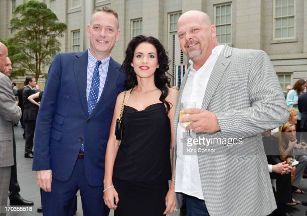 Deanna Burditt and Rick Harrison pose for a photo during a NCTA reception hosted by AE Networks at Smithsonian American Art Museum National Portrait...