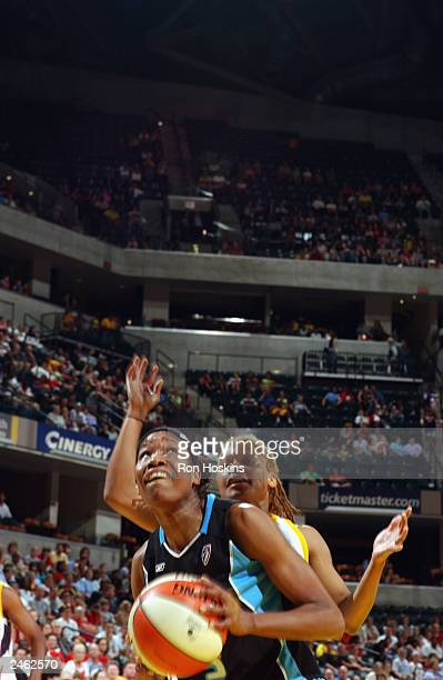 Deanna Jackson of the Cleveland Rockers goes to the basket while being defended by Coquese Washington of the Indiana Fever during the game at Conseco...