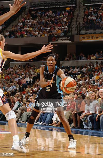 Deanna Jackson of the Cleveland Rockers passes the ball against the Indiana Fever during the game at Conseco Fieldhouse on August 23 2003 in...
