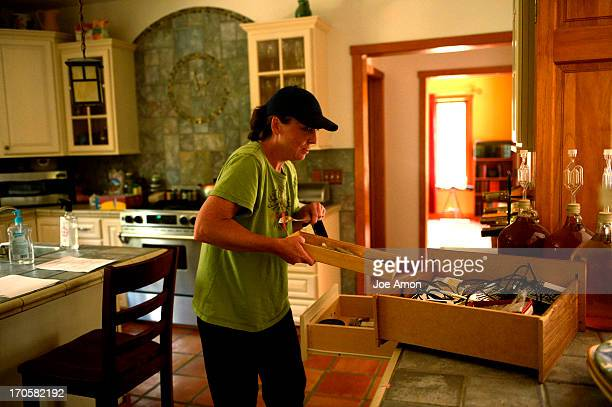Deanna Martin fills a drawer with the families account info and passwords and videos of her 2 children's childhood in the home she and her husband...