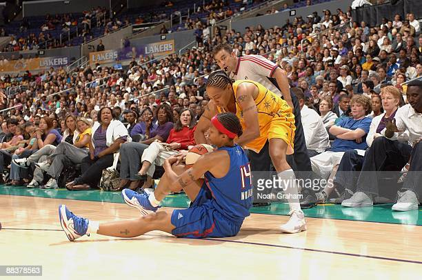 Deanna Nolan of the Detroit Shock and Betty Lennox of the Los Angeles Sparks battle for possesion during the game on June 6 2009 at Staples Center in...