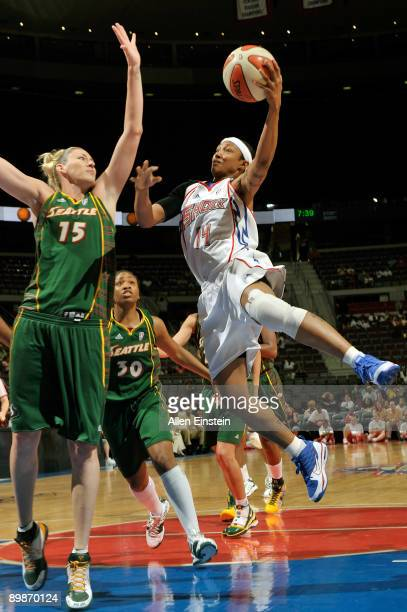Deanna Nolan of the Detroit Shock attempts a shot over Lauren Jackson of the Seattle Storm at The Palace of Auburn Hills August 18 2009 in Auburn...