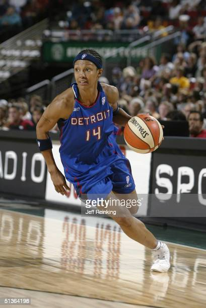 Deanna Nolan of the Detroit Shock drives against the Seattle Storm during the game at Key Arena on September 8 2004 in Seattle Washington The Storm...