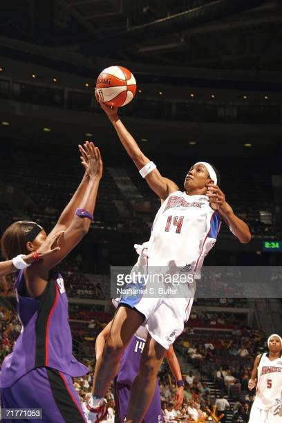 Deanna Nolan of the Detroit Shock drives to the basket against the Sacramento Monarchs during Game Two of the 2006 WNBA Finals September 1 2006 at...