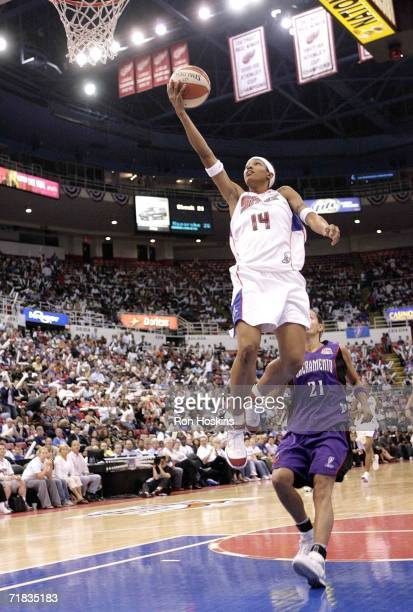 Deanna Nolan of the Detroit Shock drives to the basket against Ticha Penicheiro of the Sacramento Monarchs during Game Five of the WNBA Finals...