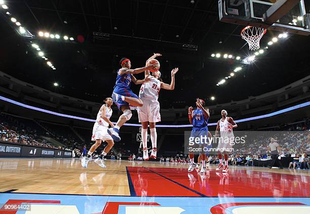 Deanna Nolan of the Detroit Shock drives to the basket during Game Two of the WNBA Eastern Conference Semifinals against Jennifer Lacy of the Atlanta...