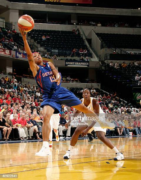 Deanna Nolan of the Detroit Shock lays the ball up on Ebony Hoffman of the Indiana Fever in Game One of the Eastern Conference Semifinals during the...