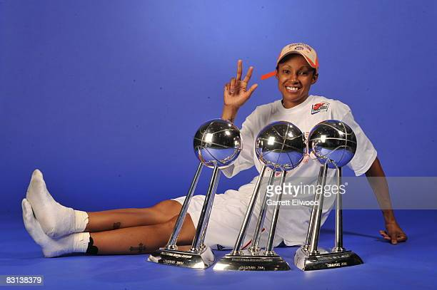 Deanna Nolan of the Detroit Shock poses for a portrait with the trophy after winning Game Three of the WNBA Finals against the San Antonio Silver...