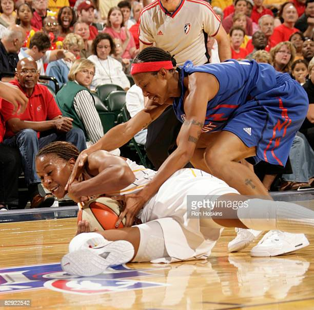 Deanna Nolan of the Detroit Shock ties up Tamika Catchings of the Indiana Fever in Game One of the Eastern Conference Semifinals during the 2008 WNBA...