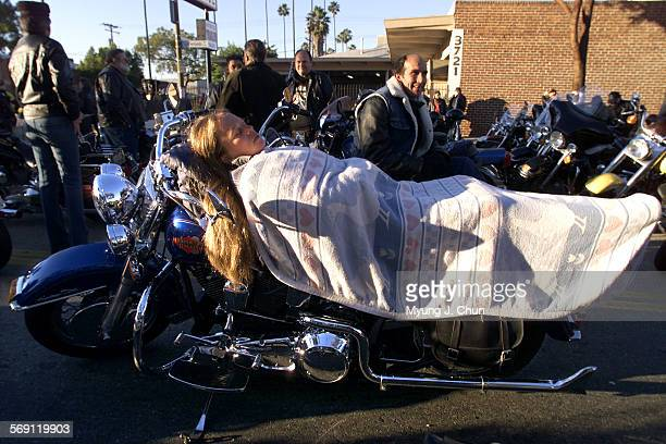 Deanna Riker of Lakewood takes a nap on her motorcycle having arrived at the staging area at 5 am Sunday to take part in the 17th annual Love Ride...