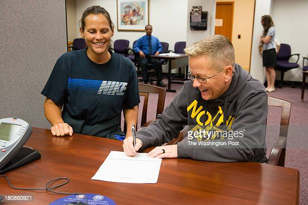 DeAnne Balausky left and Donna Baxter 49 sign paperwork for their upcoming wedding They live in Parma OH and have been together for 13 years The...