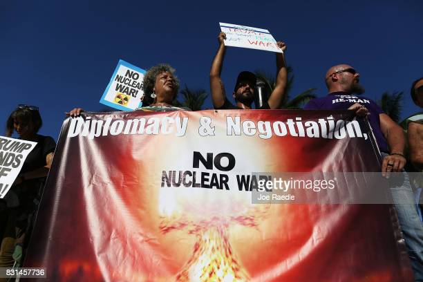 Deanne Connolly Graham Farbod Tehranian and HeMan join with protesters gathered to ask President Donald Trump to stop his drive to war against North...