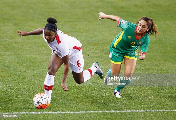 Deanne Rose of Canada battles for the ball with Ashley Rodrigues of Guyana during the 2016 CONCACAF Women's Olympic Qualifying at BBVA Compass...