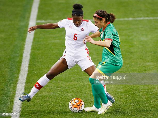 Deanne Rose of Canada battles for the ball with Kayla De Souza#4 of Guyana during the 2016 CONCACAF Women's Olympic Qualifying at BBVA Compass...