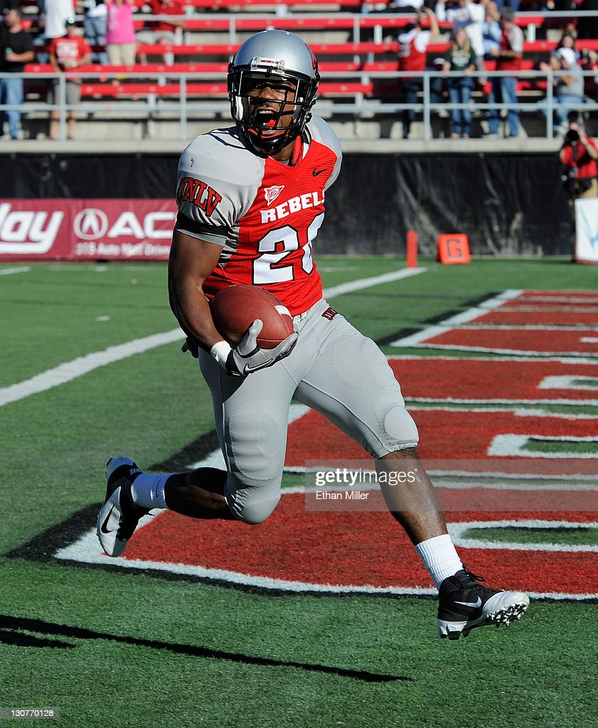 Deante Purvis #26 of the UNLV Rebels reacts as he scores a touchdown on a kickoff return during a game against the Colorado State Rams at Sam Boyd Stadium October 29, 2011 in Las Vegas, Nevada.